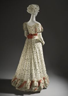 Ball gown, cotton embroidered with metallic thread and trimmed with silk ribbon, metallic passementerie and tassels, c. 1820, English.