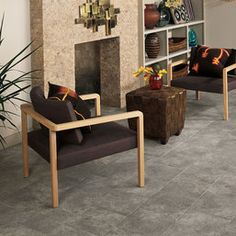 Daltile living area featuring Alta Vista in Misty Rain 12 x 12 on floor in brick joint pattern with Tumbled Stone in 1 x 2 Split Face Walnut on fireplace. Outdoor Flooring, Stone Flooring, Flooring Tiles, Floors, Tile Floor, Dal Tile, Italian Tiles, Tile Stores, Flooring Options