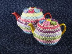 Pretty Tea Cosy by Frankie Brown - This pattern is available as a free Ravelry download The coloured stripes on this tea cosy are worked in a thick, slip stitch pattern which will help to keep the tea hot. Only small amounts of each colour are needed and the cosy is topped with little knitted flowers to match the stripes. Instructions are given for two sizes, to fit standard English three and six cup teapots.