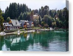 The Municipal Museum of Villa La Angostura (Spanish for Narrowness-ville) showing its reflection on the water and surrounded by pine trees on a snowy day in Río Negro, Argentina. The image gets printed onto one of our premium canvases and then stretched on a wooden frame of stretcher bars. Click through the image to customize your print for your home or office! Travel art for your wall by Eduardo Jose Accorinti.