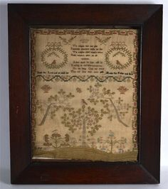 AN EARLY 19TH CENTURY FRAMED SAMPLER decorated with a poem,