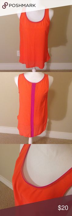 Anthropologie tank Bright orange silky tank with hot pink trim and detail on the back! Get ready for summer in this bold and bright piece! Worn once, no signs of wear!! Anthropologie Tops Tank Tops
