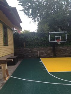 This Pro Dunk Platinum goal stands tall over a green and gold half court in this Oregon backyard. Fully adjustable for players of all shapes and sizes.