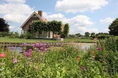 tuin tuinontwerp tuinarchitect hovenier hoveniersbedrijf tuinaanleg beplanting beplantingsplan onderhoud tuin aan het water