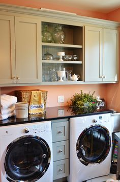 Small drawers--absolutely brilliant! If I ever get new washer/dryer, I'd love to have a shelf above them. Open shelving is nice too. Cute laundry room.