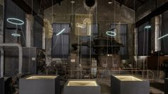 luminaries installation of neon lights and reflection on glass by studio glithero