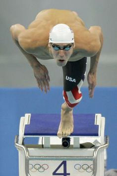 In this Aug. 14, 2008 file photo, United States' Michael Phelps  swims in a men's 100-meter butterfly heat during the swimming  competitions in the National Aquatics Center at the Beijing 2008  Olympics in Beijing.