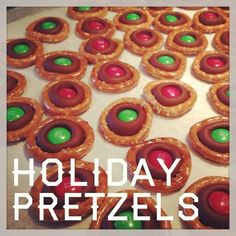Christmas pretzels - so easy and yummy! You can use Rolos or any kind of Hershey's Kiss or Hug, and various shapes of pretzels. They all taste wonderful! Kids can definitely help with these.