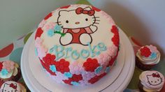 - Hello Kitty cake with matching cupcakes.  Brown sugar cake with chocolate chip cookie dough filling!