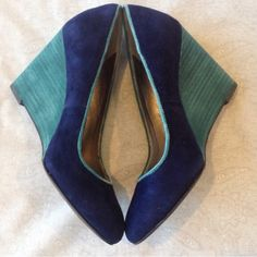 Gorgeous Lucky Brand Suede Wedges NWOT Lucky Brand suede wedges, navy and teal, such a gorgeous shoe and adds a pop of color to your outfits 😘 leather upper, man made lining, style: Carson, does not come with box but if you're interested I can sew a dust bag for them Lucky Brand Shoes Wedges