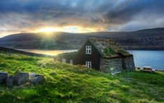 Icelandic small house - stone, timber, and sod roof - gorgeous.  And that's not even getting in to the landscape and view!