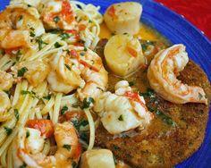 Lobster, shrimp and scallops alla scampi, served over linguine and aquick fried eggplant cutlet