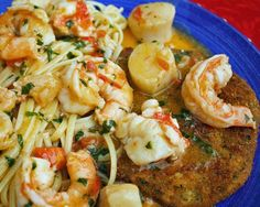Lobster, shrimp and scallops alla scampi, served over linguine and aquick fried eggplant cutlet