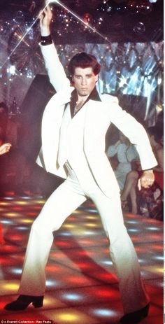 The original: Travolta first shot to fame as a disco dancer in Saturday Night Fever in 1977