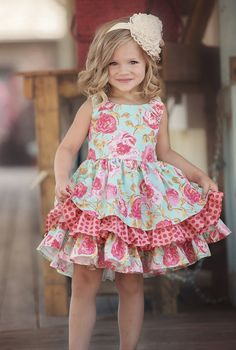 "Get an unforgettable floral look for your little girl this spring with the Persnickety Pink ""A Pocket Full of Posies"" Adeline Dress. Lightweight and durable, this dress brings flowers to the forefront in pinks, blues, and greens. The floral-themed three-layer flounce is perfect for spring and summer frolicking and formal wear, while its sleeveless design ensures that playtime stays cool when the weather gets hot. Available in sizes 2-10, the Persnickety Pink ""A Poc.."