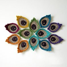 This is a listing for a pdf PATTERN in ENGLISH, not the finished product.  This is a photo tutorial with written instructions for my original Peacock Eye Feather Appliques or Motifs.  You can use these small motifs to form a peacock tail fan or, of course, any other shape you like. They would look lovely on a cushion cover or as embellishments on a box lid, bag or hat.  Each little applique measures 4 x 6.5 cm / 1.6 x 2.6 inch and I made them using mercerized cotton, which has a more lus...