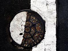 Anachropsy - photography: manhole cover