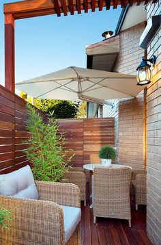 Check out this great little outdoor patio with a Shadowspec wall mounted umbrella. Outdoor Patio Umbrellas, Outdoor Umbrella, Outdoor Seating, Outdoor Dining, Outdoor Decor, Cantilever Patio Umbrella, Shade Umbrellas, Backyard Shade, Front Courtyard
