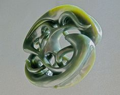 Carving by Matt Glasby...Wyoming Olive Jade..Tom is one of his students...
