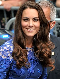 Catherine, Duchess of Cambridge: Her Tour Hairstyles!  LONG WITH LOOSE CURLS    Middleton gave her signature chestnut ringlets an off-center part.