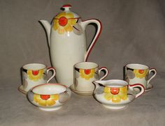 SUSIE COOPER FOR GRAYS ART DECO HANDPAINTED FLORAL COFFEE SET MARIGOLD