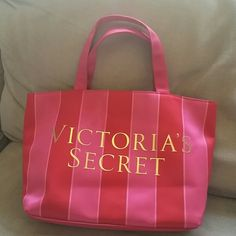 Victoria Secret bag Pink and red Victoria Secret bag.   Also it's 12 inches long and about 8 inches hight. Has a couple marks on it, but not noticeable. Still in great condition Victoria's Secret Bags Totes
