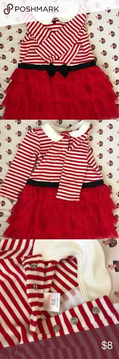 Tulle Skirt Holiday Dress Striped winter dress with collar. Black buttons and bow. Skirt is attached red tulle. Skirt is lined so no itch. All kids clothes range from brand new- gently used. The never used items have had tags removed and were washed. These items are from my personal home and stored in bins. 🌟FAST SHIPPER🌟❣️AMBASSADOR❣️💚BUNDLE TO SAVE💚Please comment with any questions. Gymboree Dresses Formal