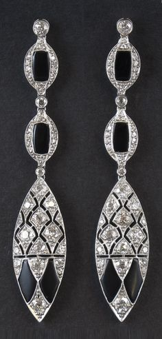A pair of Art Deco platinum, diamond and onyx earrings, about 1925. #ArtDeco #earrings