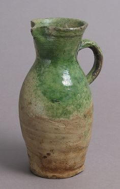 JugDate: late 1400s or early 1500s Geography: Made in probably Surrey, England Culture: British Medium: Partially glazed earthenware Dimensions: Overall: 7 x 4 1/8 x 3 3/8 in. (17.8 x 10.5 x 8.5 cm)