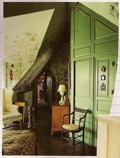 The beautiful green, the lovely mural, the little hideaway door, the hardwood, the furniture...!