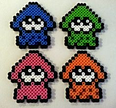 Displayed here is the collection of different colored Squids that are styled to those of the famous Splatoon video game franchise. Each squid is handcrafted from perler beads with the back completed ironed for better durability.
