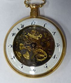 Coming up in our October 15th Jewellery auction:- an early 19th Century gentleman's 18k skeleton open faced pocket watch with repeat action by Breguet a Paris, stamped DLG K18 13591, the back plate with sunburst decoration above a vacant cartouche, 5.75cm diameter, (with a small scallop shell watch key). (2)