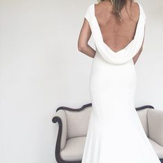 Ahhh that right there is one of our favorite dresses of ALL time....Daria by @theiacouture ! Besides having the best back the fit is phenomenal and creates the most jaw-dropping curves!! #weddingdress #wedding #theia