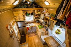 Interesting idea to have the kitchen in the main area, and living room under the loft. I like how it's separate! Gives the living room a more cozy feeling.