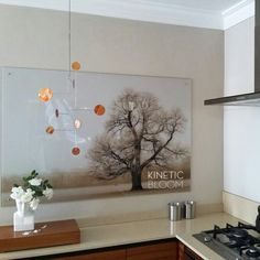 Our beautiful 'bauhaus' mobile is making its way to one lucky buyer in the USA.  Spreading peace and harmony around the world..  ..here it is hanging in our own kitchen showing its generous proportions and the glowing patina of the copper discs.