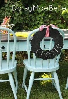 Painting a child's table and chairs alongside a chalkboard wreath... how pretty!  / Daisy Mae Belle