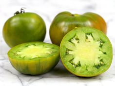 Green Moldovan Tomato: Bright lime-green fruit have a tropical taste. This variety has round, flattened, 10-oz beefsteak-type fruit