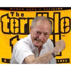 """Myron Cope (January 23, 1929 – February 27, 2008) known as """"The voice of the Pittsburgh Steelers"""" for 35 years. Cope played a large role in the invention of the Terrible Towel.   """"I said, what we need is something that everybody already has, so it doesn't cost a dime. So I says, 'We'll urge people to bring out to the game gold or black towels,' then I'll tell people if you don't have a yellow, black or gold towel, buy one. And if you don't want to buy one, dye one. We'll call this the…"""