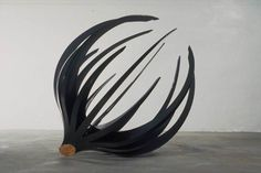 Cut Off 1990, Wood and mixed media, 58 x 48 x 48 inches,  Fritz Dietel Sculpture