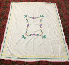A personal favorite from my Etsy shop https://www.etsy.com/listing/486646765/tablecloth-vintage-appliqued-and