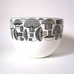 This bowl is a great example of Scandinavian design at its finest. White enamel with a wide band of whimsical line drawings of mushrooms in black.