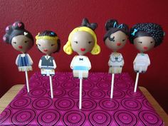 "BFF bridesmaid.com loves these Harajuku girls themed cake pops. Shy Cakes in LA make them look like your future bridesmaids and probably have them wear bridesmaids gowns. You can put in letters in the back ""Will you be my bridesmaid?"""