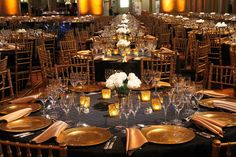 gold napkins, gold chargers on black pintuck linen