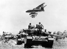 The Iron Curtain Torn By Israel. An Israeli Vautour bomber flies over tanks assembling in the Negev desert on May two weeks before the outbreak of the Six Day War. Travel Store, Warsaw Pact, Israel Palestine, Victoria, Military Jets, Military Vehicles, Air Force, Monster Trucks, Places To Visit