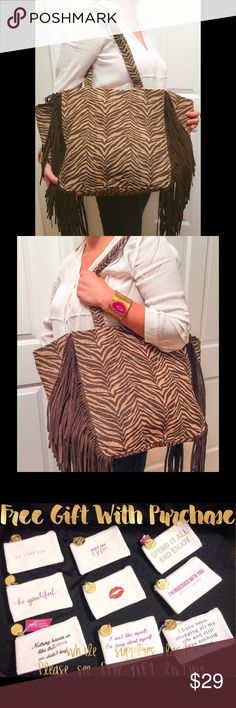 "Zebra Jute Tote w/ Suede Fringe NEW/ PURCHASED AT A WHOLESALER SAMPLE SALE. A statement maker, this trendy bag bag is made of natural Jute with a brown zebra design, gold shimmer and genuine brown suede fringe. The inside is lined with a sturdy linen like fabric and a snap closure. Dimensions 13 1/2"" W x 6 1/2"" D x 5 1/2"" H 2Chic Bags Totes"