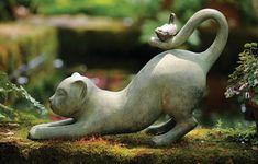 garden cat w/ bird on his tail