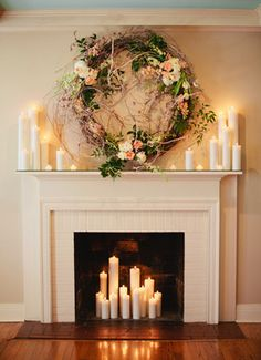 Candles in fireplace and on mantle with floral garland. A Nashville wedding photo taken at Cedarwood Weddings