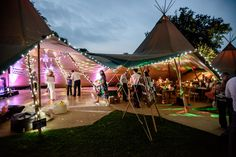 The lovely Katie and John held their delightfully decorated tipi wedding early last month at Bradshott Hall in Hampshire. They filled the tipis with so many fab personal touches - a mix of beautiful table decor, cute signage and a wonderfully eclectic bright cupcake tower as their wedding cake. Thanks to the super talented www.angelawardbro... for sharing these photos with us!