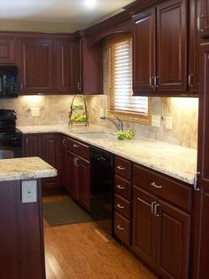 Kitchen Ideas Cherry Cabinets traditional kitchen with subway tile, l-shaped, pendant light