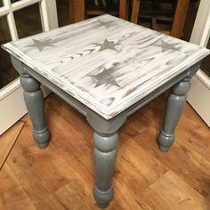Coffee table painted in Autentico Evening Shadow with white wax. The top has been given a beach wood, white washed effect with distressed star stencils. Love how this one turned out!